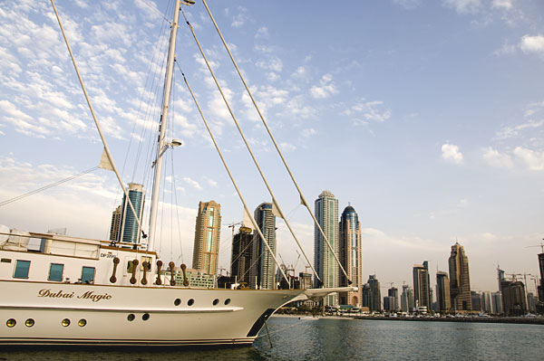 Yacht with Dubai Marina in the background